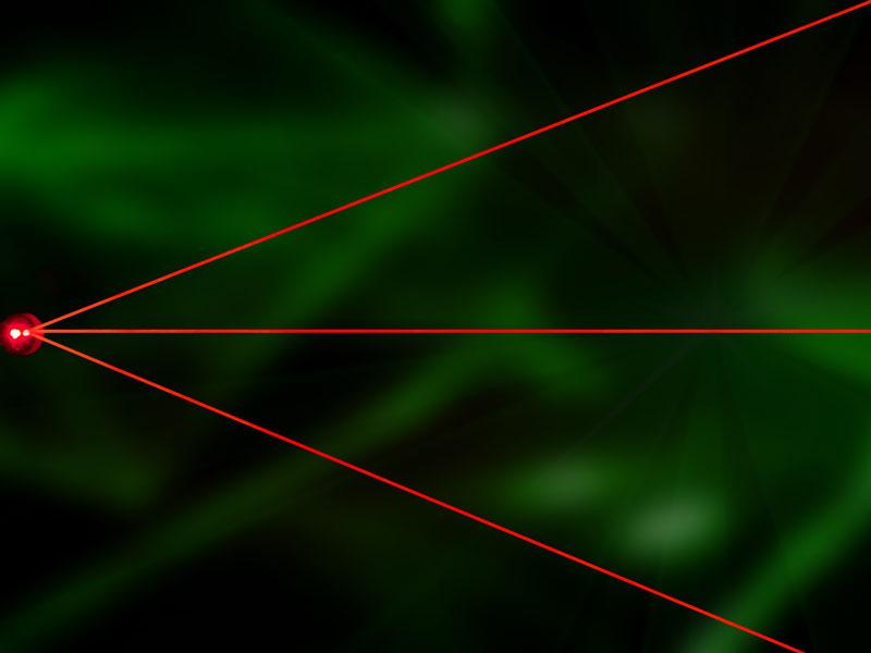rote Laserstrahlen auf einen Punkt zentriert